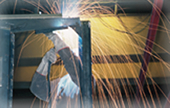An industrial welder at work